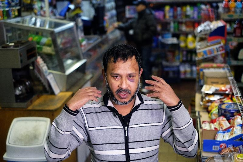 Muslim shopkeeper Sarkar Haq, who was beaten in an alleged hate crime, speaks during an interview at his shop in New York on December 7, 2015 (AFP Photo/Jewel Samad)