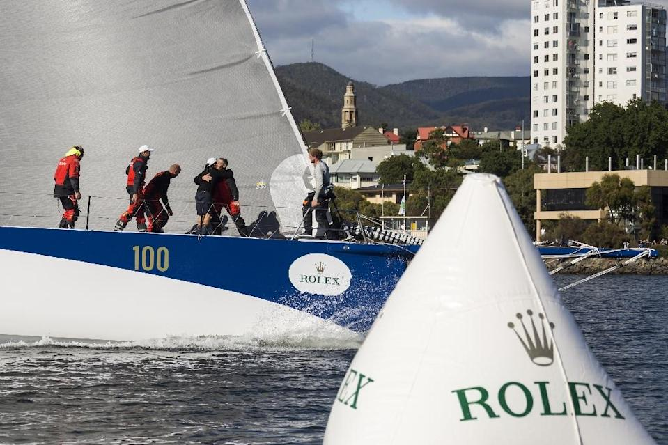 Ragamuffin 100 arrives in Hobart at the end of the Sydney to Hobart yacht race (AFP Photo/Stefano Gattini)
