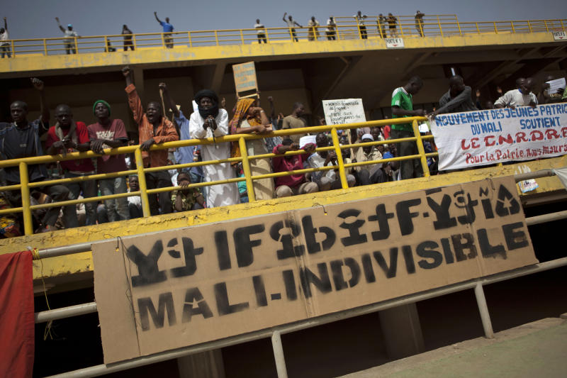 A banner reads 'Mali, indivisible,' at a rally in support of the ruling military junta attended by roughly one thousand people in a stadium with a capacity of 50,000, in Bamako, Mali Saturday, March 31, 2012. The March 26 stadium is named in commemoration of the date in 1991 when dictator Moussa Traore was overthrown, paving the way for establishment of a democracy which lasted 21 years until mutinous soldiers took power in a coup nine days ago. (AP Photo/Rebecca Blackwell)