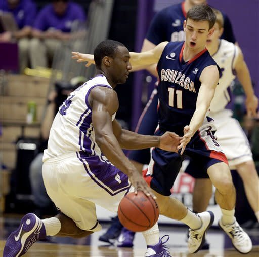 Gonzaga guard David Stockton (11) defends against Portland guard Derrick Rodgers during the first half of an NCAA college basketball game in Portland, Ore., Thursday, Jan. 17, 2013. (AP Photo/Don Ryan)