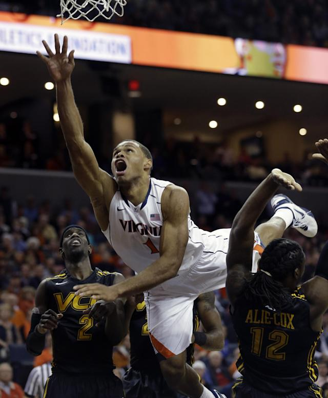 Virginia guard Justin Anderson (1) watches a shot as Virginia Commonwealth guard Briante Weber (2) and Virginia Commonwealth forward Mo Alie-Cox (12) defend during the second half of an NCAA college basketball game in Charlottesville, Va., Tuesday, Nov. 12, 2013. VCU won 59-56. (AP Photo/Steve Helber)
