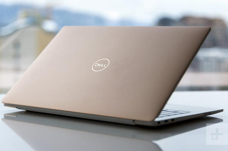 Dell XPS 13 9370 review   Laptop partially closed facing away from the camera at an angle showing lid and trim