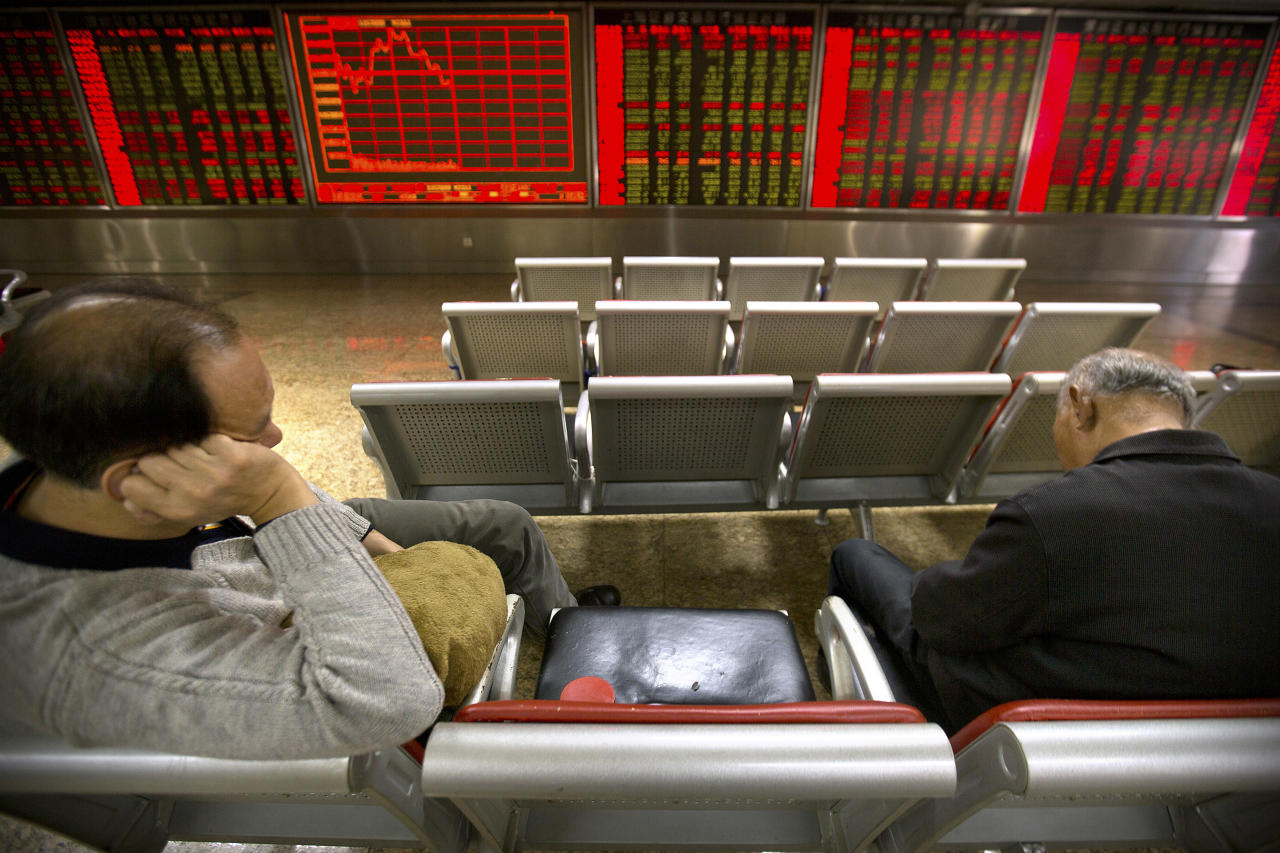 Chinese investors nap while monitoring stock prices at a brokerage house in Beijing, Wednesday, Nov. 22, 2017. Asian stocks rose Wednesday after Wall Street hit new highs ahead of the two-day U.S. break for the Thanksgiving holiday. (AP Photo/Mark Schiefelbein)