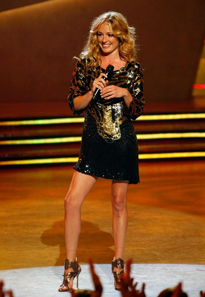 """Welcome to the jungle! <a href=""""/cat-deeley/contributor/2212390"""">Cat Deeley</a> wore a sequined dress emblazoned with an image of a leopard and sky-high gladiator sandals for the 100th episode of <a href=""""/so-you-think-you-can-dance/show/36160"""">""""So You Think You Can Dance.""""</a>"""