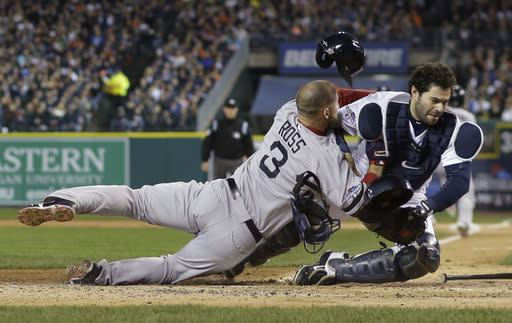 Boston Red Sox's David Ross is out at home on a fielder choice collides with Detroit Tigers catcher Alex Avila in the second inning during Game 5 of the American League baseball championship series Thursday, Oct. 17, 2013, in Detroit. (AP Photo/Matt Slocum)