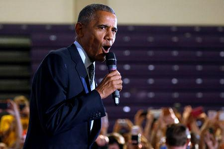 """U.S. President Barack Obama greets supporters in an overflow room before he participates in a """"Get Out the Early Vote"""" campaign event for Hillary Clinton in Columbus, Ohio, U.S., November 1, 2016.   REUTERS/Jonathan Ernst/File Photo"""