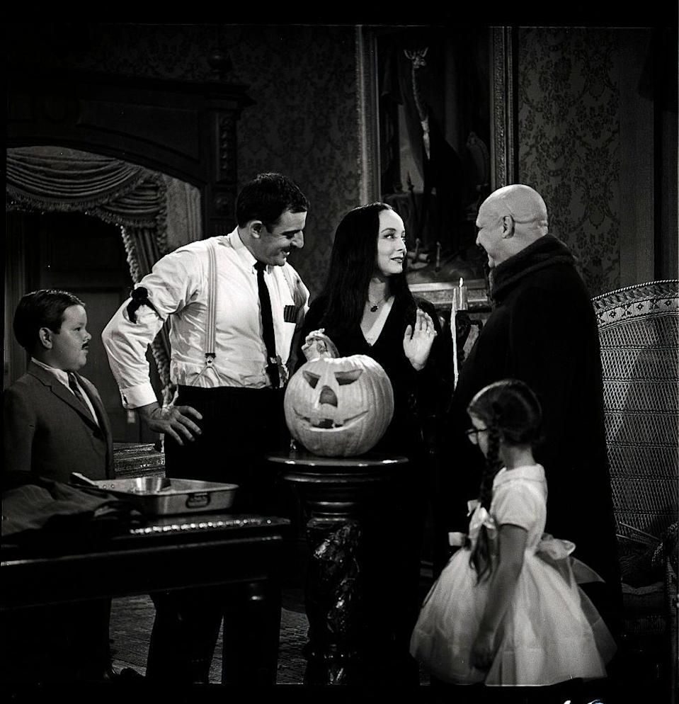 """<p><em> The Addams Family </em>hit the air on September 18, 1964, and the show's seventh episode<em>,</em> """"Halloween with the Addams Family,"""" became an instant classic in its own right. It was so revered, in fact, that NBC turned it into a television movie in 1977, 11 years after the show went off the air. </p>"""
