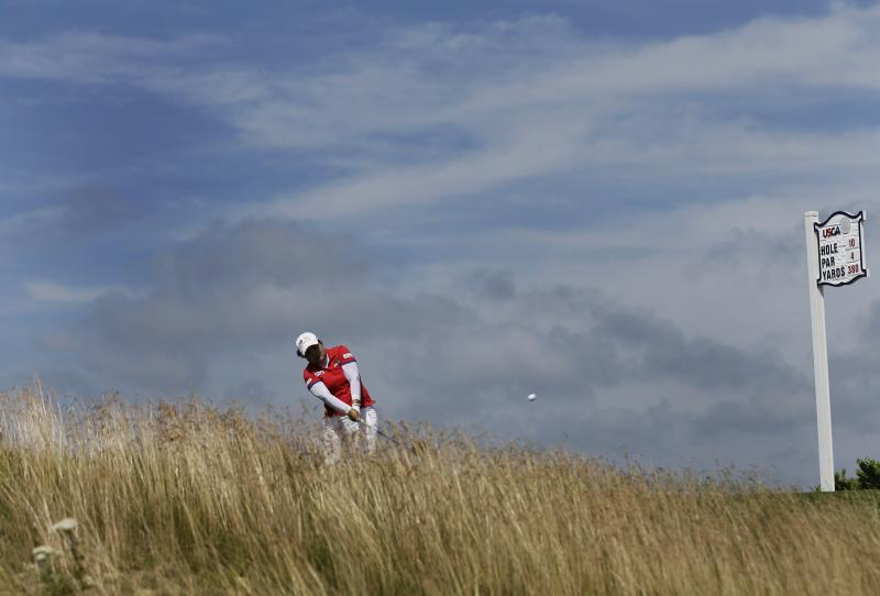 Inbee Park, of South Korea, tees off on the 10th hole during the third round of the U.S. Women's Open golf tournament at the Sebonack Golf Club Saturday, June 29, 2013, in Southampton, N.Y. (AP Photo/Frank Franklin II)