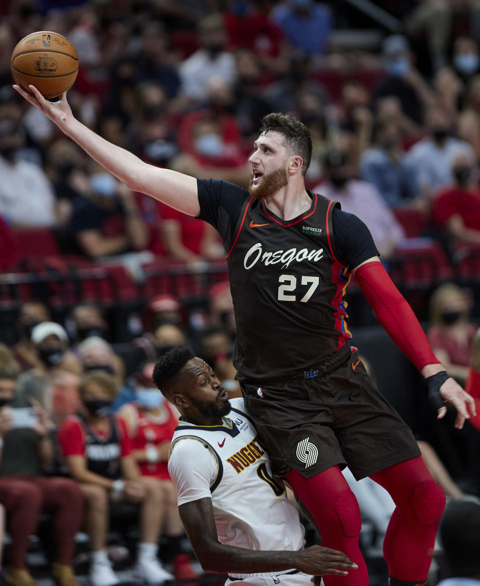 Portland Trail Blazers center Jusuf Nurkic shoots over Denver Nuggets forward JaMychal Green during the second half of Game 6 of an NBA basketball first-round playoff series Thursday, June 3, 2021, in Portland, Ore. (AP Photo/Craig Mitchelldyer)
