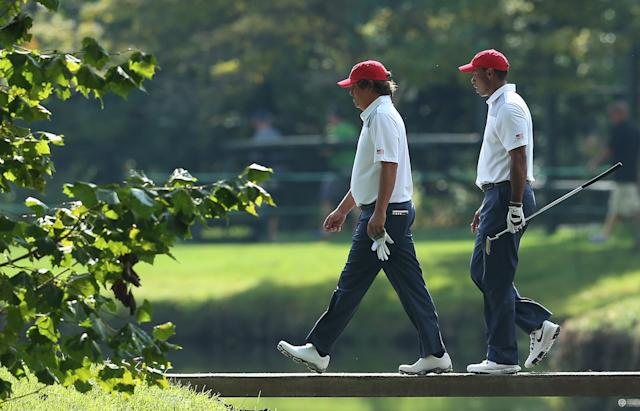 DUBLIN, OH - OCTOBER 01: Jason Dufner (L) and Tiger Woods of the U.S. Team cross a bridge during a practice round prior to the start of The Presidents Cup at the Muirfield Village Golf Club on October 1, 2013 in Dublin, Ohio. (Photo by Andy Lyons/Getty Images)