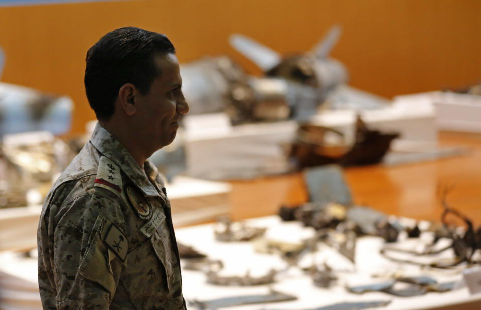 Saudi military spokesman Col. Turki al-Malki displays what he describes as an Iranian cruise missile and drones used in an attack this weekend that targeted the heart of Saudi Arabia's oil industry, during a press conference in Riyadh, Saudi Arabia, Wednesday, Sept. 18, 2019. Though Yemen's Houthi rebels claimed the assault, the U.S. alleges Iran was behind it. (AP Photo/Amr Nabil)