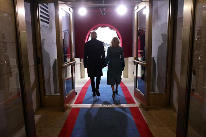 President Joe Biden and First Lady Jill Biden walk onto the front balcony of the US Capitol during his inauguration ceremony. (Getty Images)