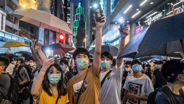 Hong Kong voters defy Beijing, throw support behind protest leaders in unofficial primary vote