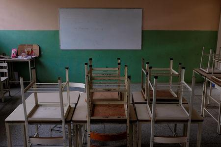 Empty desks are seen in the classroom on the first day of school, in Caucagua, Venezuela September 17, 2018. REUTERS/Marco Bello