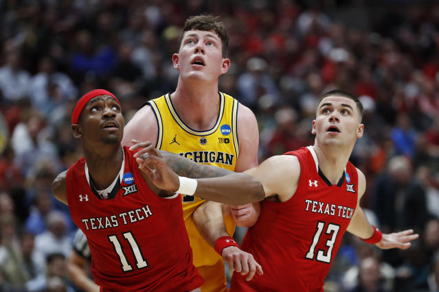 <p>Jon Teske #15 of the Michigan Wolverines fights for position against Tariq Owens #11 and Matt Mooney #13 of the Texas Tech Red Raiders during the 2019 NCAA Men's Basketball Tournament West Regional at Honda Center on March 28, 2019 in Anaheim, California. (Photo by Sean M. Haffey/Getty Images) </p>