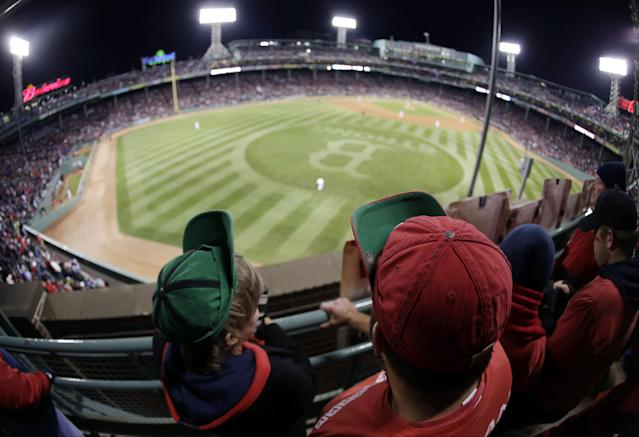 Boston Red Sox fans wear rally caps during the eighth inning of Game 2 of baseball's World Series against the St. Louis Cardinals Thursday, Oct. 24, 2013, in Boston. (AP Photo/Charlie Riedel)