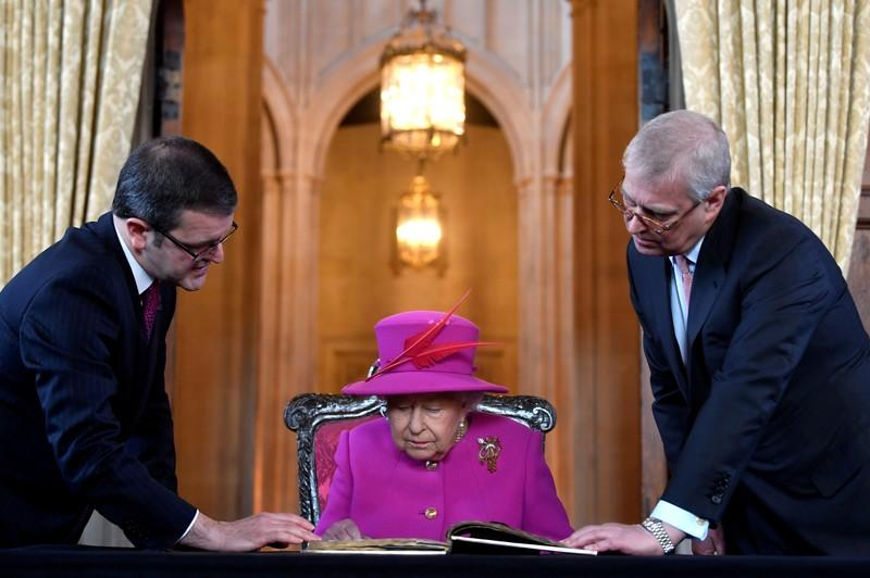 FILE PHOTO: Britain's Queen Elizabeth, accompanied by Prince Andrew, visits The Honourable Society of Lincoln's Inn to open the new Ashworth Centre, and re-open the recently renovated Great Hall, in London