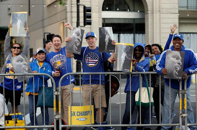 <p>Fans wait for a parade and rally to start in honor of the Golden State Warriors, Thursday, June 15, 2017, in Oakland, Calif., to celebrate the team's NBA basketball championship. (AP Photo/Marcio Jose Sanchez) </p>