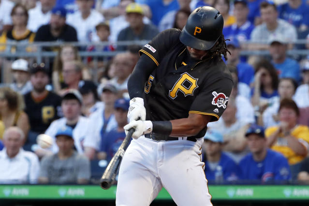 FILE - In this July 1, 2019, file photo, Pittsburgh Pirates' Josh Bell hits a three-run home run off Chicago Cubs starting pitcher Adbert Alzolay during the first inning of a baseball game in Pittsburgh. Bell is among eight competitors in this years All-Star Game Home Run Derby, which is handing out a $1 million prize to the winner. (AP Photo/Gene J. Puskar, File)
