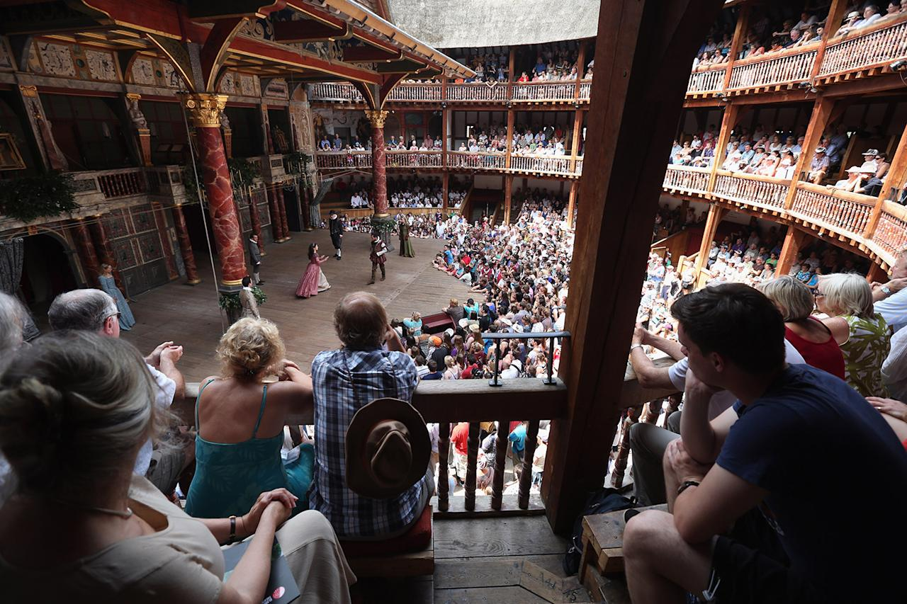 "<p>Audience members watch a production of ""A Midsummer Night's Dream"" in Shakespeare's Globe Theatre, on the Southbank of the River Thames, in London. (Photo: Oli Scarff/Getty Images) </p>"