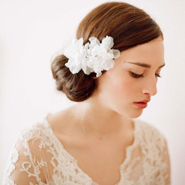 """<div class=""""caption-credit""""> Photo by: Etsy seller Twigs & Honey</div><div class=""""caption-title"""">13. Flower Power</div>Depending on your wedding dress, a floral-inspired hair accessory might be a perfect fit. In my opinion, you've got to go big with a handmade flower in shades of white or ivory. These pieces are incredibly ethereal. <br> <br> <a rel=""""nofollow noopener"""" href=""""http://www.etsy.com/listing/92916462/bridal-silk-hair-flowers-small-silk"""" target=""""_blank"""" data-ylk=""""slk:Organza silk flowers"""" class=""""link rapid-noclick-resp"""">Organza silk flowers</a> by Etsy seller Twigs & Honey. <br>"""