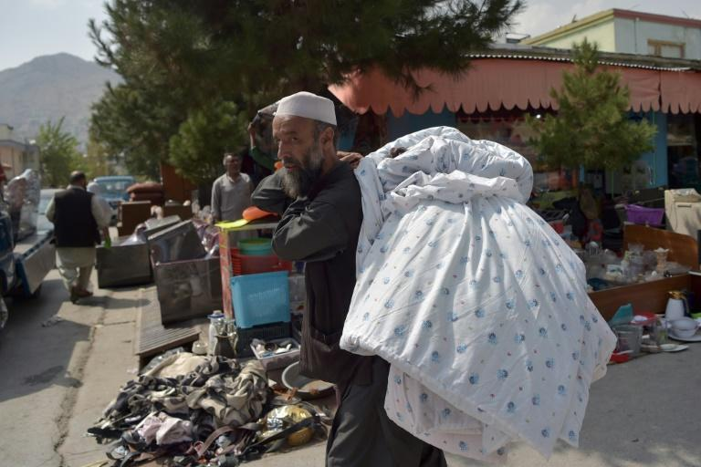 Many people have sold off their belongings to finance their journey out of Afghanistan (AFP/WAKIL KOHSAR)