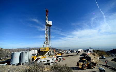 FILE PHOTO: Crews from Southern California Gas Company and outside experts work on a relief well at the Aliso Canyon gas field above the Porter Ranch section of northwest Los Angeles