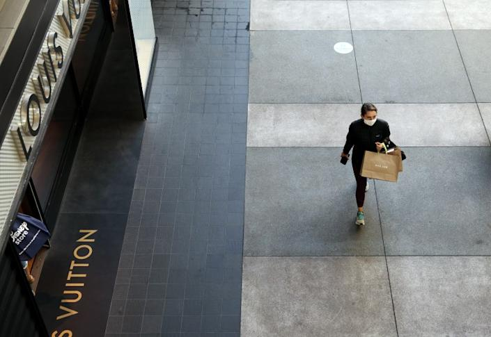 SANTA MONICA-CA-NOVEMBER 13 2020: A lone shopper passes by the Louis Vuitton store at Santa Monica Place on Friday, November 13, 2020. (Christina House / Los Angeles Times)