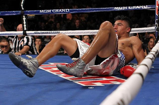 Victor Ortiz is knocked out by Floyd Mayweather Jr. in the fourth round of their 2011 WBC welterweight world title fight (AFP Photo/AL BELLO)