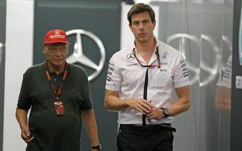 Toto Wolff, right, walks with former F1 champion Niki Lauda - Credit: AP