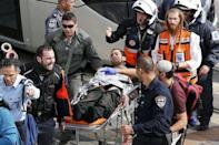 Israeli medics and emergency personnel evacuate a wounded Israeli from the scene of a stabbing in Pisgat Zeev, which lies on occupied land that Israel annexed to Jerusalem after the 1967 Middle East war, November 10, 2015. REUTERS/Ammar Awad