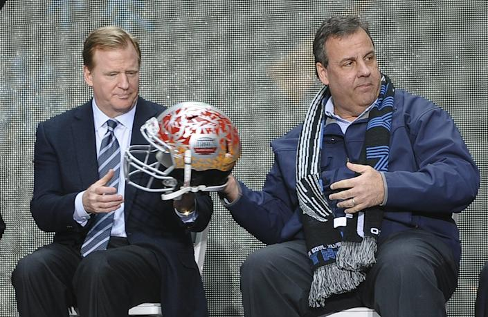 NFL Commissioner Roger Goodell (L) and New Jersey Governor Chris Christie attend a ceremony on February 1, 2014  at Times Square in New York where the NY/NJ Super Bowl Host Committee leaders will join with city and state dignitaries to ceremoniously handoff hosting duties to the Arizona Host Committee, the day before  Super Bowl XLVIII between the Denver Broncos and the Seattle Seahawks. (Photo credit should read TIMOTHY A. CLARY/AFP/Getty Images)