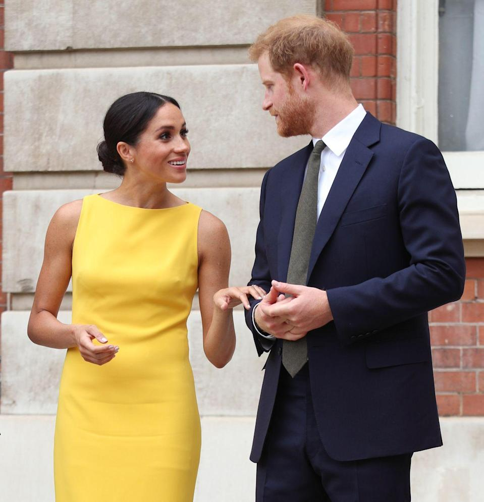 "<p>Meghan and Harry shared a sweet look just before the Duke gave a speech at the event. Meghan wore <a href=""https://www.townandcountrymag.com/style/fashion-trends/a22062433/meghan-markle-brandon-maxwell-dress-commonwealth-youth-challenge-reception/"" rel=""nofollow noopener"" target=""_blank"" data-ylk=""slk:a bright yellow dress by Brandon Maxwell"" class=""link rapid-noclick-resp"">a bright yellow dress by Brandon Maxwell</a> for the day.</p>"