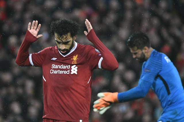 Salah celebrates after scoring in the semi-final against Roma at Anfield (AFP Photo/Filippo MONTEFORTE)