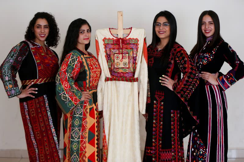 Models present traditional Palestinian dresses at Al Hanouneh society for popular culture in Amman
