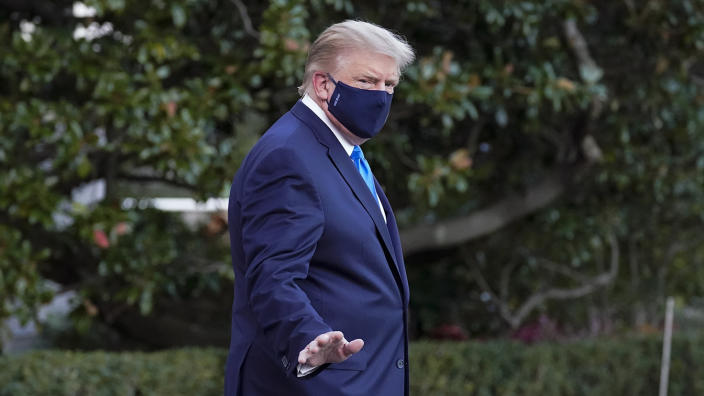 President Donald Trump waves to members of the media as he leaves the White House to go to Walter Reed National Military Medical Center after he tested positive for COVID-19, Friday, Oct. 2, 2020, in Washington. (AP Photo/Alex Brandon)