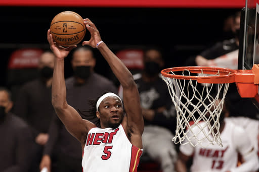 Miami Heat forward Precious Achiuwa dunks during the first half of an NBA basketball game against the Brooklyn Nets, Monday, Jan. 25, 2021, in New York. (AP Photo/Adam Hunger)