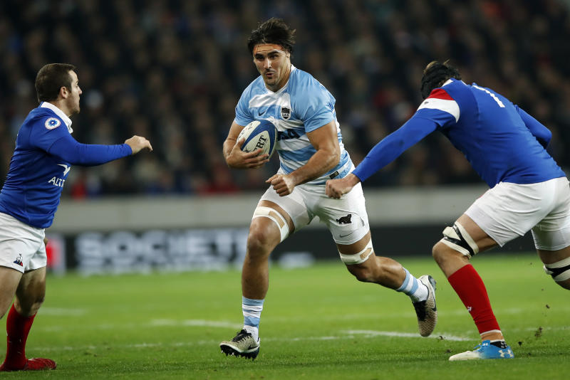 FILE - In this Nov. 17, 2018, file photo, Argentina's Pablo Matera, center, tries to pass between France's Camille Lopez, left, and France's Arthur Iturria during a rugby union international match between France and Argentina at the Pierre Mauroy stadium, in Lille, northern France. While Argentina has strength in depth and a powerful pack it clearly must finish better to have a chance of reaching a first Rugby World Cup final. Imposing captain Matera leads a powerful backrow and the flanker has good hands as well as a great offload. (AP Photo/Christophe Ena, File)