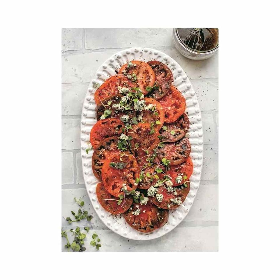 """<p>It doesn't get much easier than slicing tomatoes. Still, you won't believe how satisfying this easy g0-with-anything summer salad is. <br></p><p>For the salad: <br>2 homegrown tomatoes, sliced ¼ inch thick<br>½ teaspoon kosher salt<br>½ teaspoon freshly cracked black pepper<br>¼ cup crumbled Gorgonzola<br>Balsamic Vinaigrette (recipe below) <br>Fresh herbs or microgreens, for garnish</p><p>1.Place the tomatoes on a platter and sprinkle them with the salt and pepper. <br>2. Crumble on the Gorgonzola and then drizzle with the vinaigrette.<br>3. Garnish with fresh herbs or microgreens. Serve immediately. </p><p>For the balsamic vinaigrette: <br>2 tablespoons balsamic vinegar<br>1 garlic clove, minced<br>1 teaspoon brown sugar<br>½ teaspoon Dijon mustard<br>Pinch of kosher salt and black pepper<br>½ cup extra-virgin olive oil</p><ol><li>In a small bowl, whisk together the vinegar, garlic, brown sugar, mustard, salt, and pepper.</li><li> Stream in the olive oil while whisking until the dressing is emulsified.</li><li> Store in a sealed container in the fridge and<br>shake or whisk before using.</li></ol><p><em>Recipe excerpted from <a href=""""https://www.amazon.com/Everyday-Dinners-Real-Life-Recipes-Success/dp/0593137493/?tag=syn-yahoo-20&ascsubtag=%5Bartid%7C10072.g.36679190%5Bsrc%7Cyahoo-us"""" rel=""""nofollow noopener"""" target=""""_blank"""" data-ylk=""""slk:Everyday Dinners"""" class=""""link rapid-noclick-resp"""">Everyday Dinners</a> </em><em>by Jessica Merchant. </em></p>"""