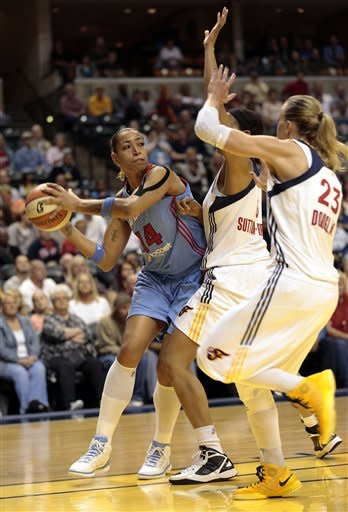 Atlanta Dream forward Erika de Souza, left, looks to pass around Indiana Pacers defenders Tammy Sutton-Brown, center, and Katie Douglas during the first half of a WNBA basketball first-round playoff game in Indianapolis, Tuesday, Oct. 2, 2012. (AP Photo/AJ Mast)
