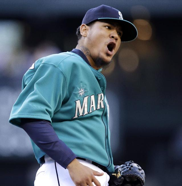 Seattle Mariners starting pitcher Felix Hernandez lets out a yell after retiring Houston Astros' Marc Krauss in the second inning of a baseball game Friday, May 23, 2014, in Seattle. Krauss grounded to first baseman Justin Smoak, who tossed it to Hernandez for the out. (AP Photo/Elaine Thompson)