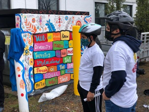 People receiving a new bike were given helmets, bike locks and a few safety lessons about riding a bike around the city.