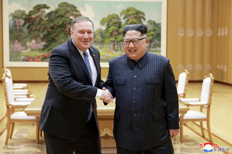 North Korean leader Kim Jong Un shakes hands with U.S. Secretary of State Mike Pompeo in this May 9 photo by North Korea's Korean Central News Agency in Pyongyang.