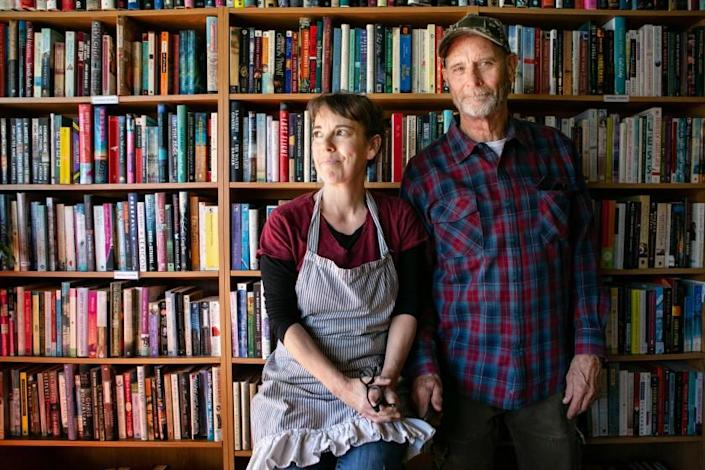 YREKA, CA - MARCH 04: Guy and Debbie Scott, owners of Zephyr Books & Coffee in Yreka, poses for a portrait on {wdt} in Yreka, CA. Zephyr Books & Coffee in rural Northern California serves as a location to sign a petition to recall Gavin Newsome. (Jason Armond / Los Angeles Times)