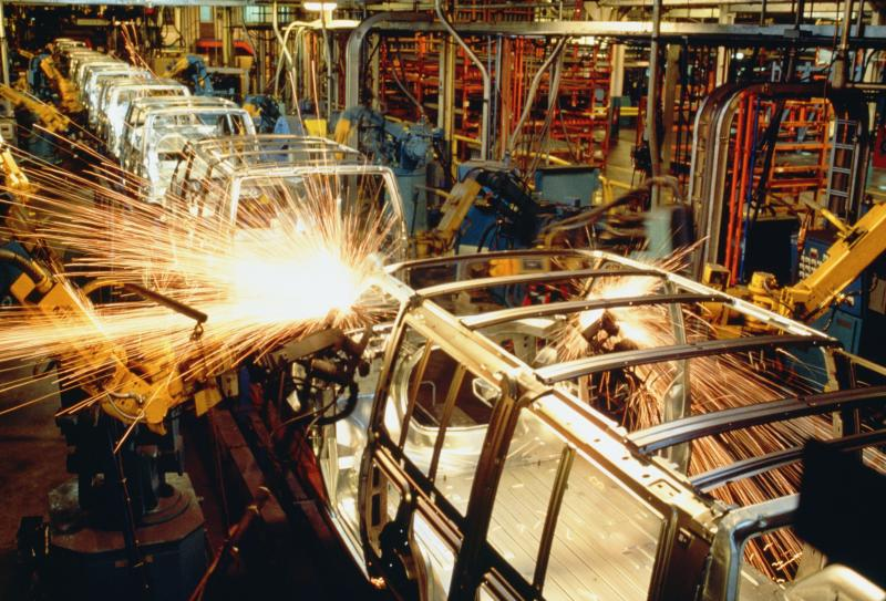 Robots welding automobile van bodies on an assembly line, Baltimore, Maryland, USA