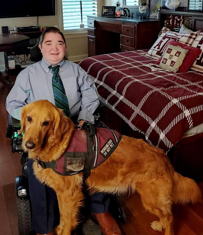 Image: Kyle Cox with his service dog, Amber.