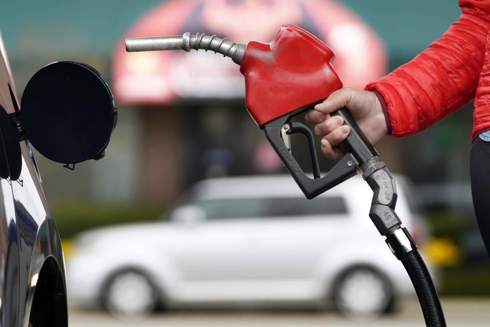 A motorist prepares to pump gas Thursday, April 22, 2021, in Portland, Maine. President Joe Biden committed the United States to cutting emissions by up to 52% by 2030 at a virtual Earth Day summit. (AP Photo/Robert F. Bukaty)