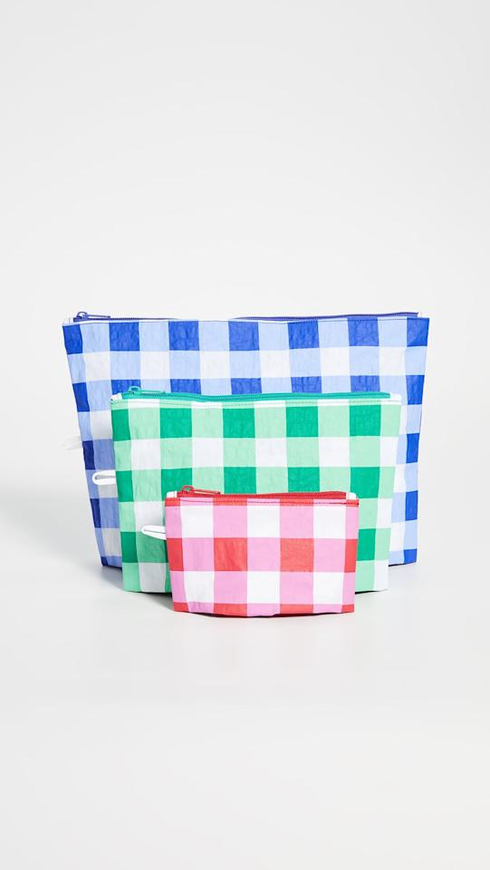 """<p>""""I haven't packed a bag - even a purse! - without this handy <a href=""""https://www.popsugar.com/buy/Baggu%20Go%20Pouch%20set-474035?p_name=Baggu%20Go%20Pouch%20set&retailer=shopbop.com&pid=474035&price=38&evar1=fab%3Aus&evar9=46438805&evar98=https%3A%2F%2Fwww.popsugar.com%2Ffashion%2Fphoto-gallery%2F46438805%2Fimage%2F46440494%2FBAGGU-Go-Pouch-Set&list1=shopping%2Cmust%20haves%2Ceditors%20pick%2Csummer%2Csummer%20fashion&prop13=api&pdata=1"""" rel=""""nofollow"""" data-shoppable-link=""""1"""" target=""""_blank"""" class=""""ga-track"""" data-ga-category=""""Related"""" data-ga-label=""""https://www.shopbop.com/pouch-set-baggu/vp/v=1/1535768924.htm"""" data-ga-action=""""In-Line Links"""">Baggu Go Pouch set</a> ($38) all Summer. They keep me organized, and they're cute enough to carry on their own; so, yeah, I'm a big fan."""" - HWM</p>"""