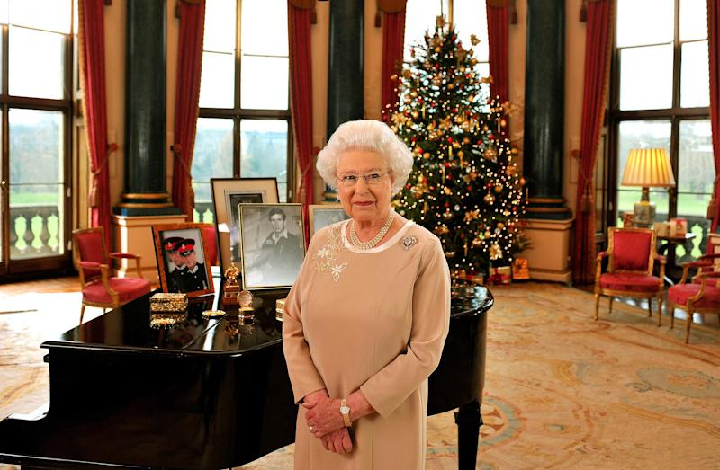 LONDON - DECEMBER : (NO PUBLICATION IN UK MEDIA FOR 28 DAYS) Queen Elizabeth II stands in the Music Room of Buckingham Palace after recording her Christmas day message to the Commonwealth on December 2008 in London, England. (Anwar Hussein Collection/Rota/WireImage)