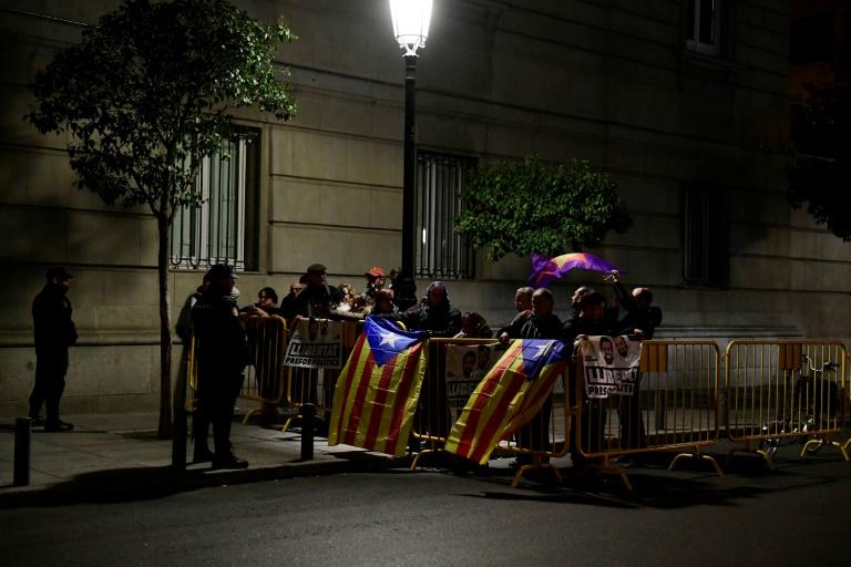 Protesters blocked roads and train lines across Catalonia on Wednesday, provoking commuter anger in a strike called by a pro-independence union over the arrests